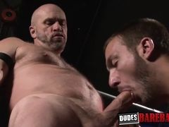 Rough daddy barebacks submissive guy in the sex dungeon