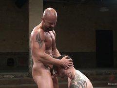 oiled muscle men wrestle