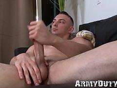 Handsome trooper grabs his hard cock and masturbates solo