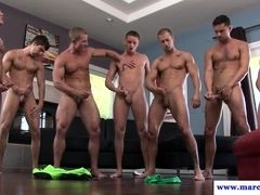 Muscular hung hunk cum showered in orgy
